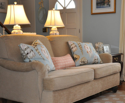 upholstered living room couch with warm light