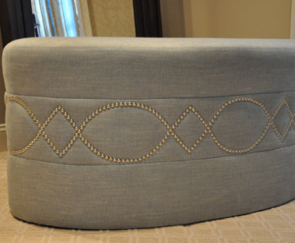 upholstered ottomon with detail