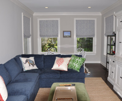 family room with wraparound couch and table