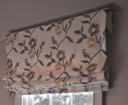 roman shade over window